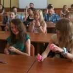 students learning a song